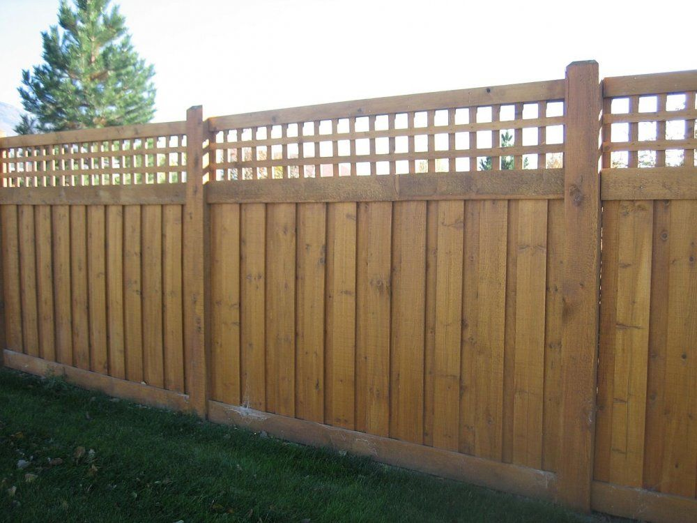 This Wood Fence Design Uses Pine Boards With A Lattice Top