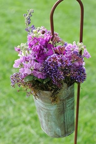 This Wildflower Bouquet In County Pail Hanging On A Shepherd Hook Is Filled With Lilacs And Other Purple Lavender Colored Wildflowers