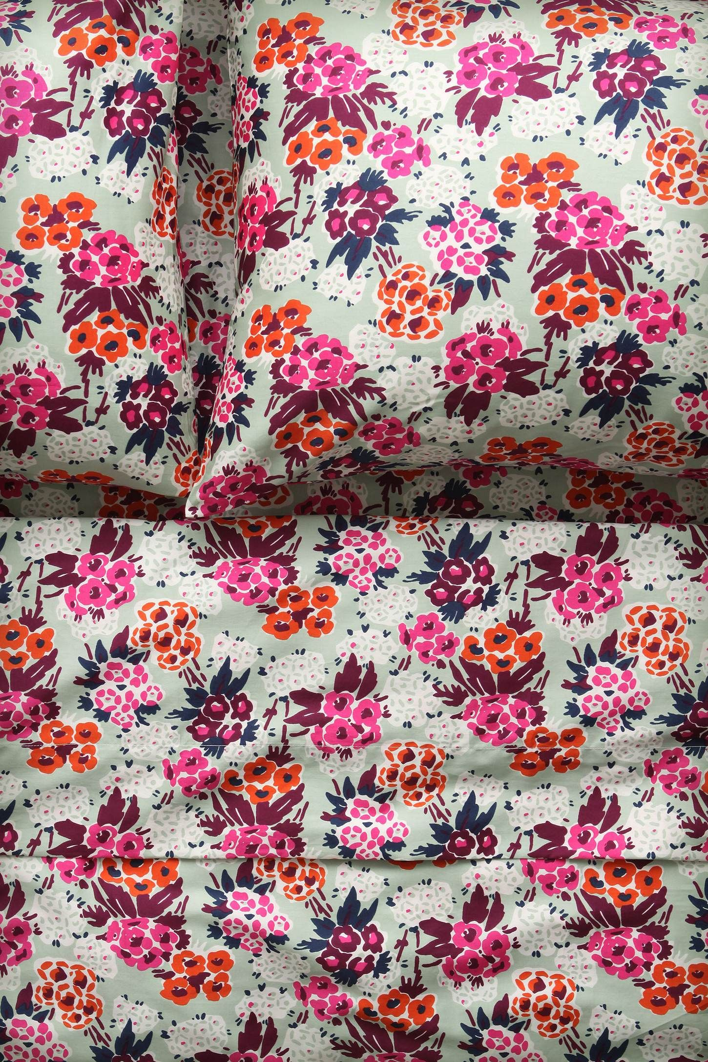 Floral bedding in pink and orange
