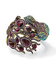 "Pretty purple peacock. You don't have to ruffle your feathers to get attention in this vibrant-colored peacock bangle bracelet. Set with multiple colors and shapes of dazzling crystals, this playful hinged bracelet is 7"" length. Antiqued goldtone metal. fashionbug.com"