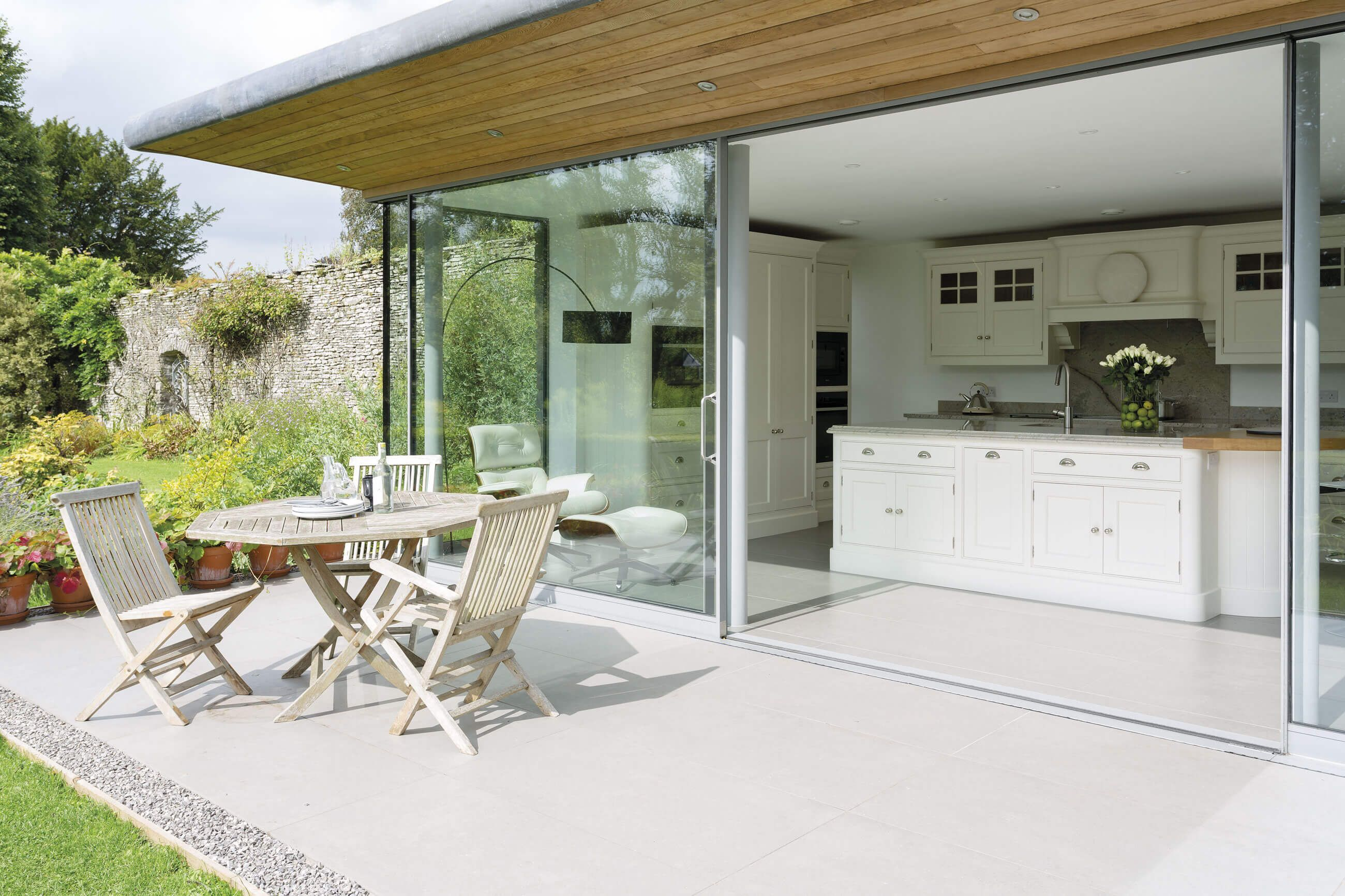 This indoor-outdoor kitchen with bi-fold doors is the perfect ...