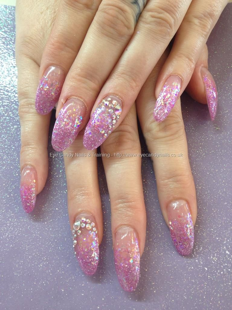 Almond acrylic nails with pink glitter fade and Swarovski crystals ...