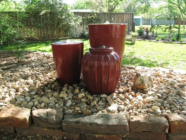 Add a water feature or flower pot groupings after filling for Pot water feature ideas