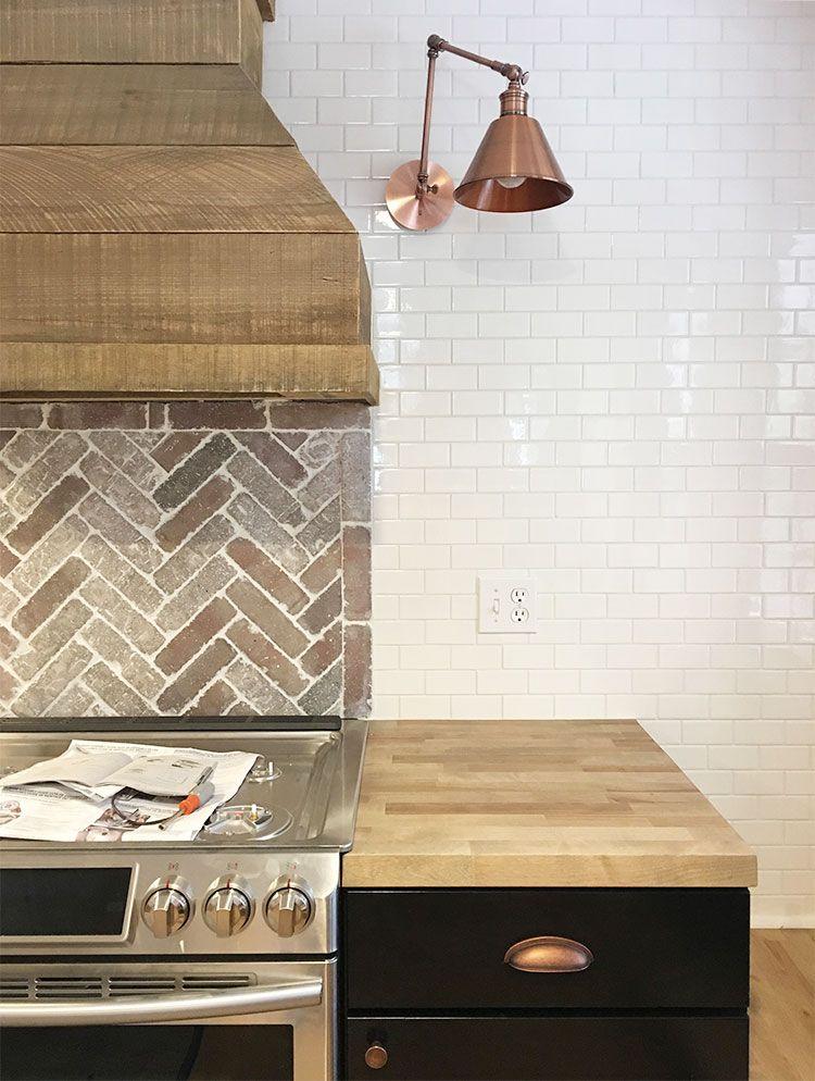 Copper Sconces And Hardware Brick Herringbone Backsplash Subway Tile Butcher Block Counters Herringbone Backsplash Brick Backsplash Kitchen Green Backsplash