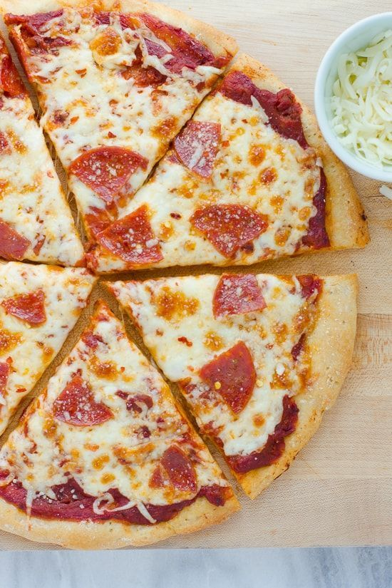 GlutenFree Pizza Crust EASY to make and works with basically any glutenfree flour blend Bakes up chewy and crispyThe Best GlutenFree Pizza Crust EASY to make and works wi...