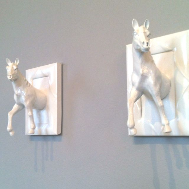 DIY wall hangers at my salon (created with toy horses, picture frames, & paint)