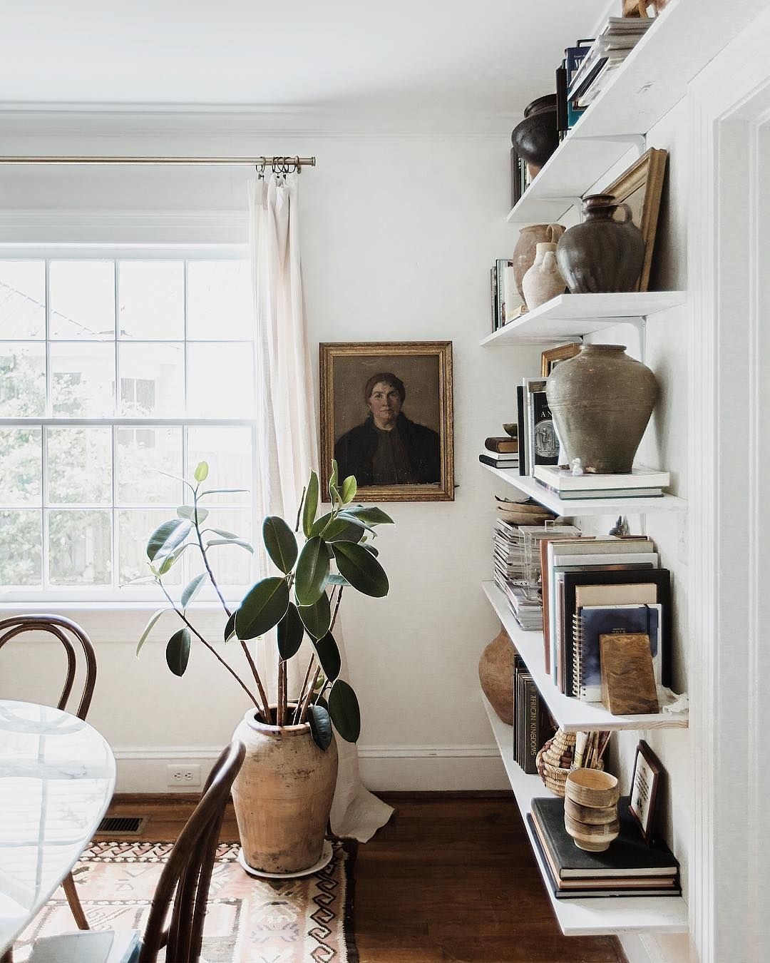 Books paintings pottery plants and of course rugs - How much do interior designers make a year ...