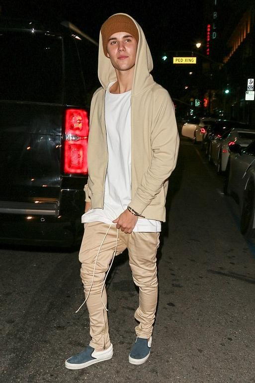Justin Bieber wearing Vans Wool Sport Slip-on Sneakers, Yea. Nice the Fold Beanie in Coffee Brown, Fear of God Drawstring Trousers and Fear of God French Terry Raglan Hoodie in Khaki