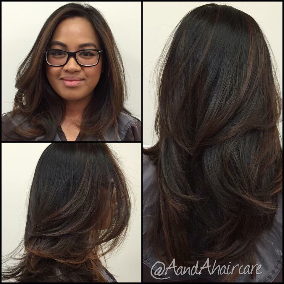 subtle sun kissed balayage on someone with natural dark