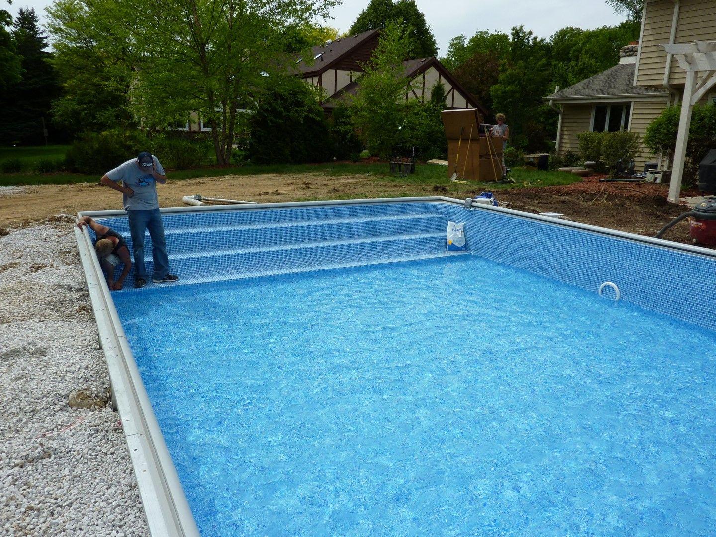 Custom inground pool steps made of concrete steel or