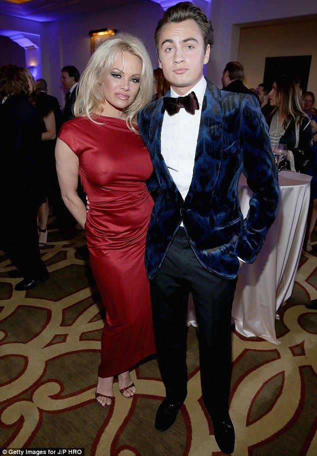 Handsome Escort Beautiful Pamela Anderson 48 Was Accompanied By Her Son Brandon Lee At The Help Haiti