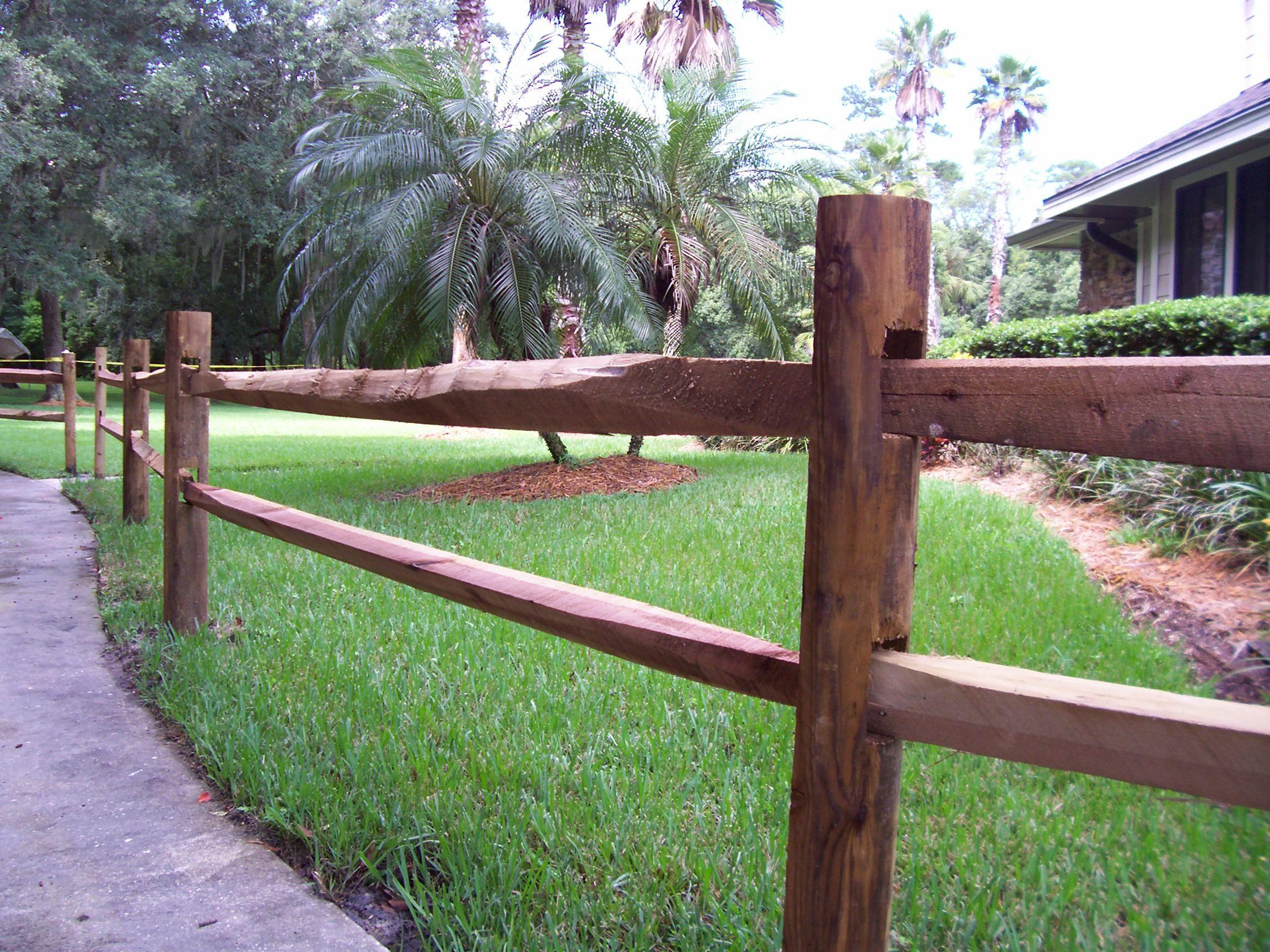 Custom wood split rail horse fence by Mossy Oak Fence pany