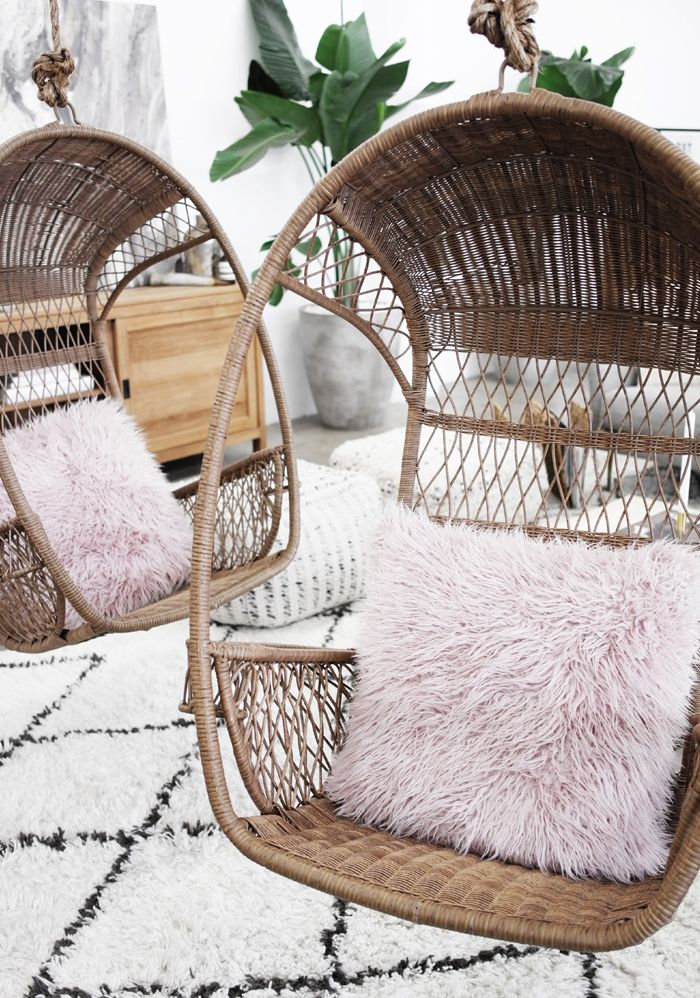 Blush Faux Fur Pillow With Hanging Wicker Swing Chair And Moroccan Rug