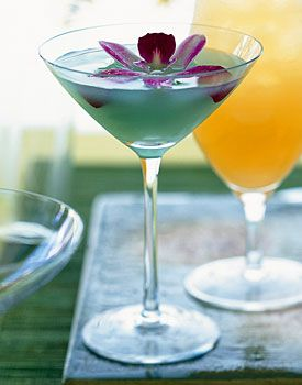 Aqua Pearl~  Guanabana or Pineapple juice, Gin, Fresh lemon juice, Simple Syrup, Blue Curaçao, Angostura bitters...