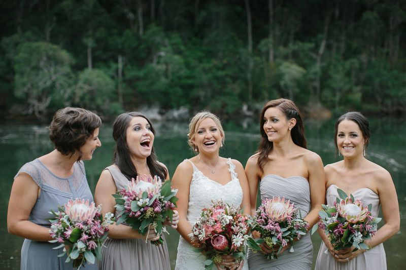 Bride And Her Bridesmaids In Dove-grey Dresses With