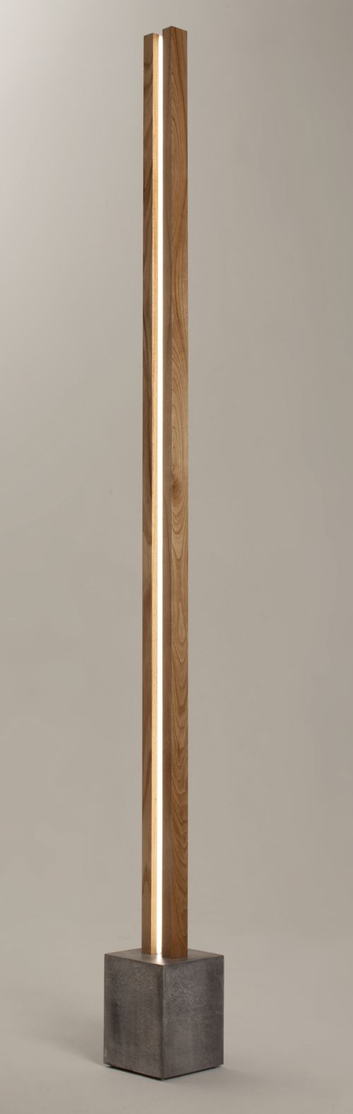 The Lubois : a floor lamp with a clear LED light strip inside a vertical structure in wood