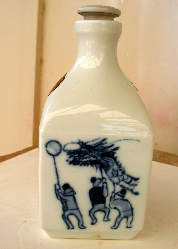 Vintage Japanese Sake Bottle Porcelain Blue and White with Hand Painted Scenes.