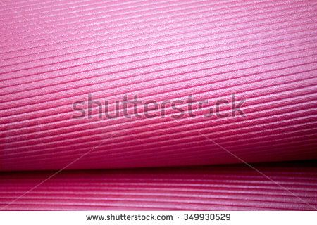 Fitness, yoga and pilates foam mat in gymnasium yoga studio.