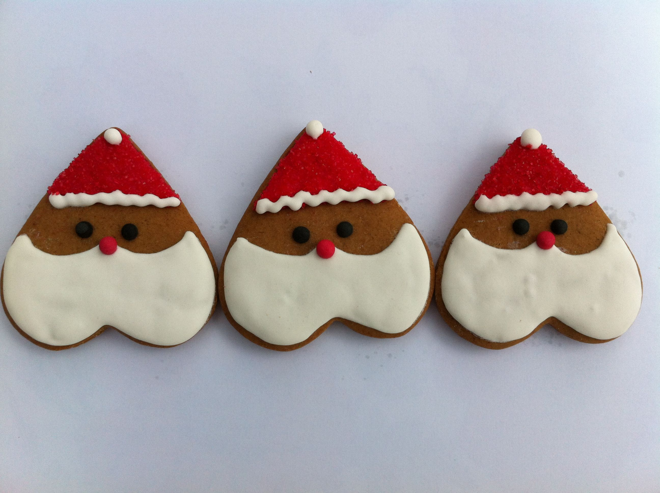 Santa Ginger Bread Cookies Using A Heart Shaped Cookie Cutter