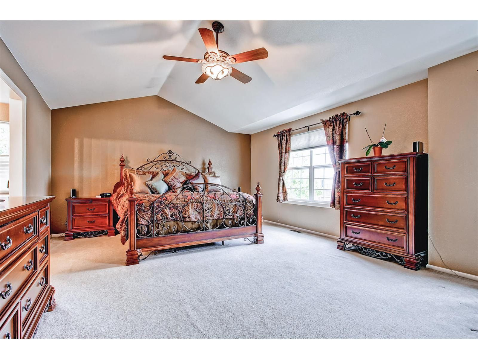 Large master bedroom with vaulted ceilings and ceiling fan ...