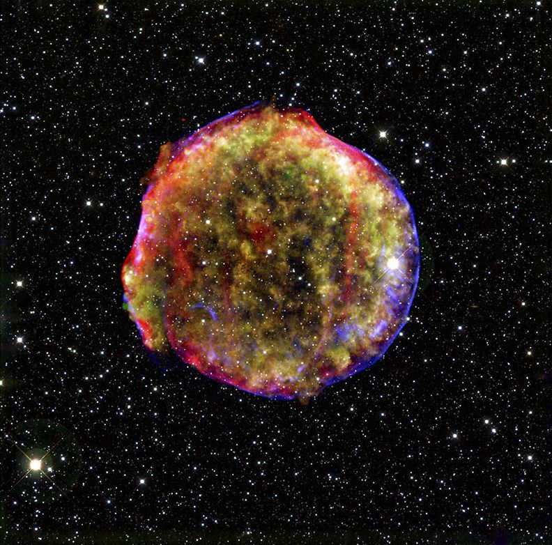 Tycho's supernova remnant, the result of a stellar explosion first recorded over 400 years ago by the famous astronomer Tycho Brahe.  The expanding gas cloud is extremely hot, while slightly different expansion speeds have given the cloud a puffy appearance