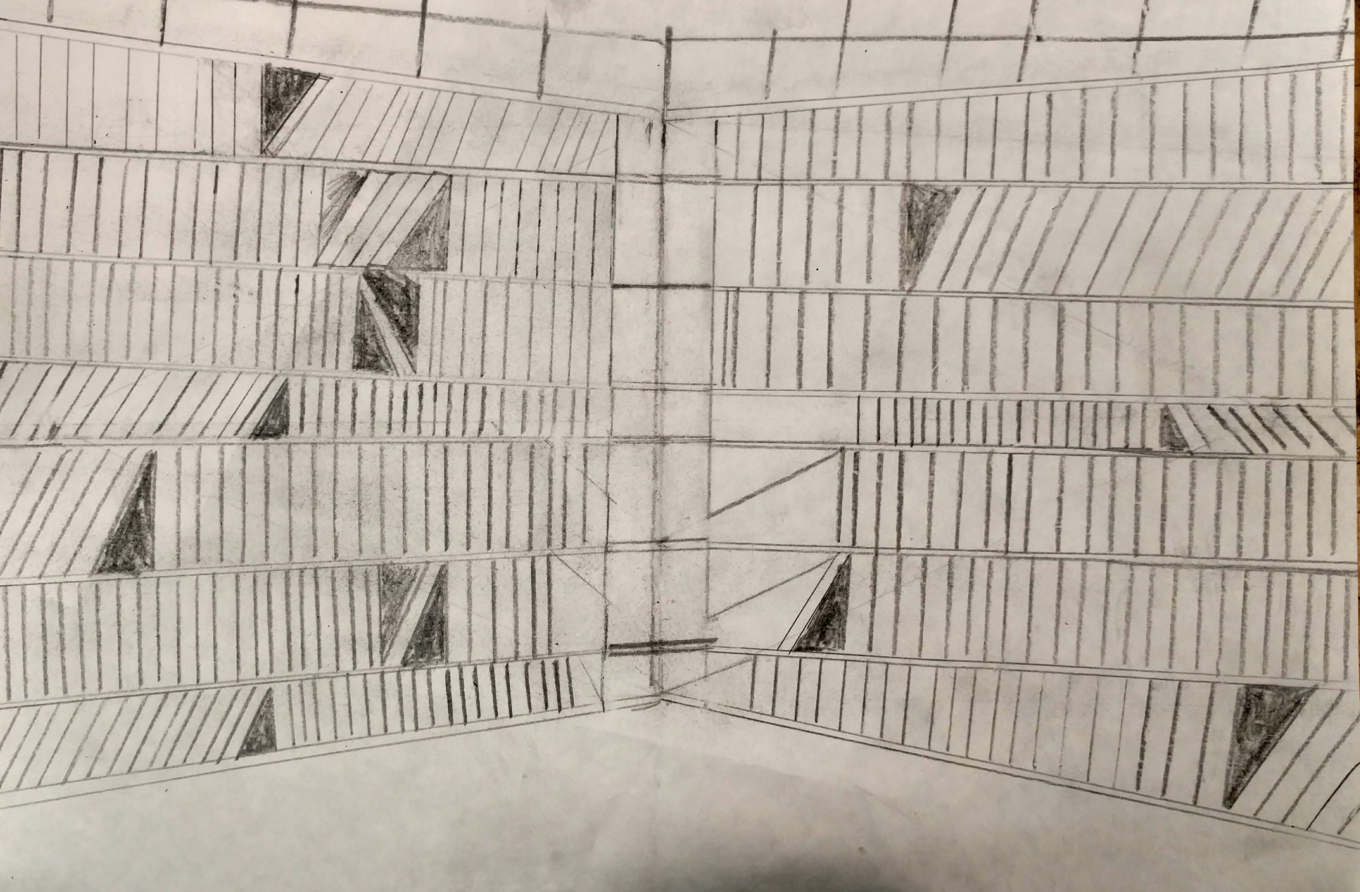 Title: Two-Point Perspective Project Medium: Graphite A two-point perspective drawing of a library. Made with pencil. I used Two-Point Perspective to show two walls come together in a corner. I shaded in shadows.
