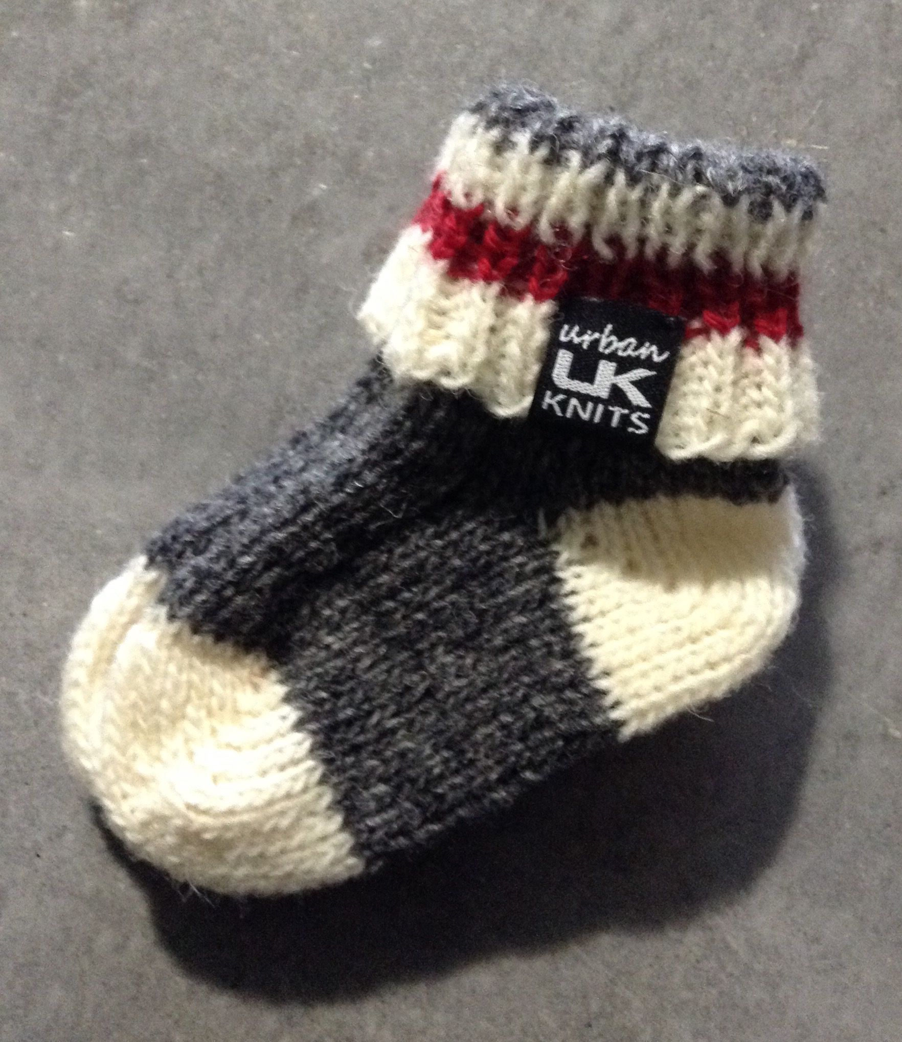 Newborn slipper socks knit in Briggs and Little wool So cozy and