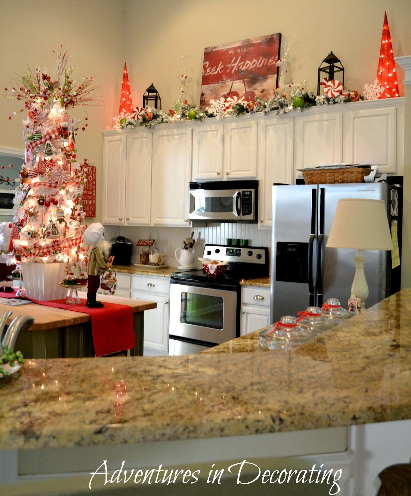 love the lit garland and beautiful christmas decor above cabinets and another tree in the on kitchen cabinets xmas decor id=71958