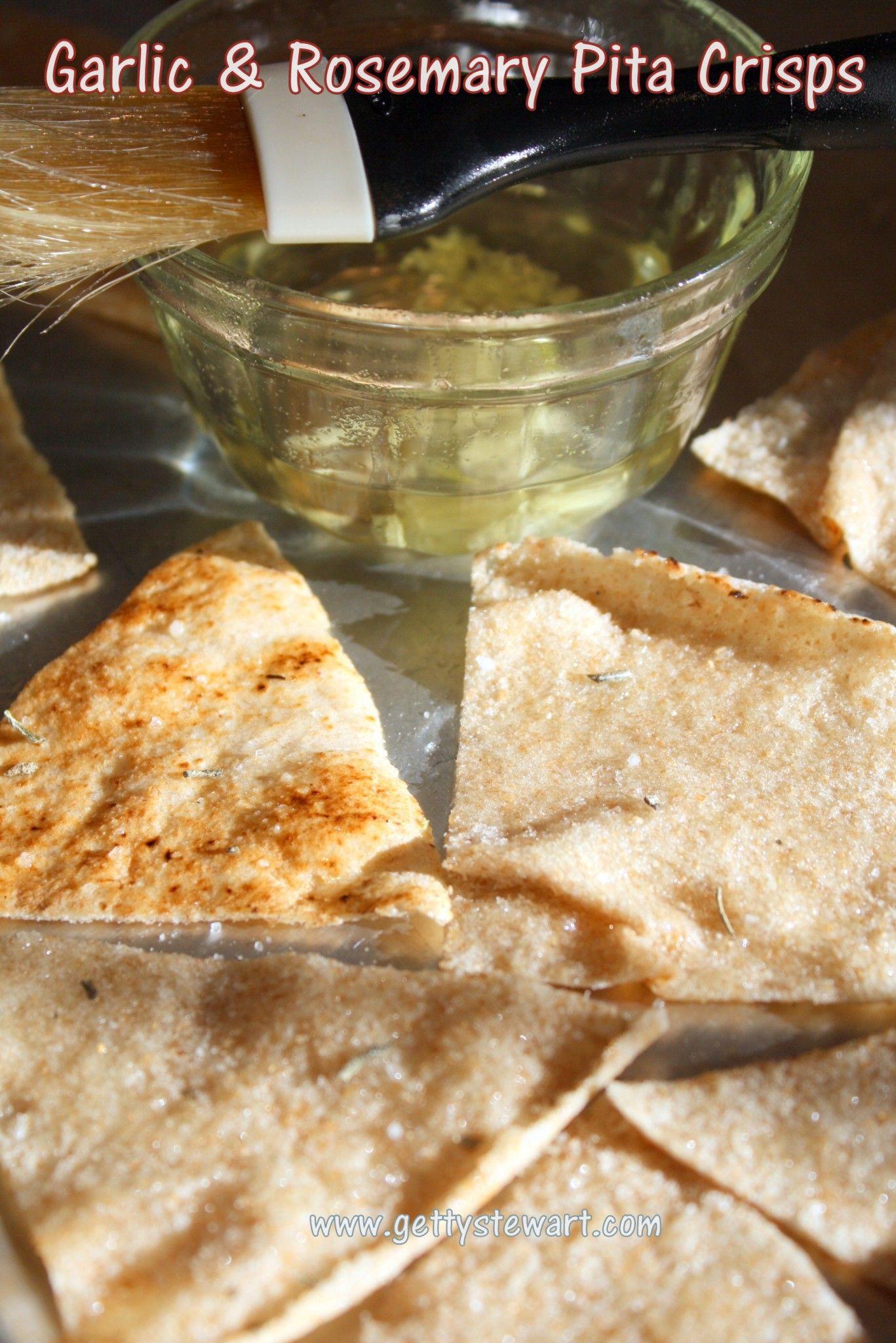 Homemade baked pita crisps with garlic and rosemary salt