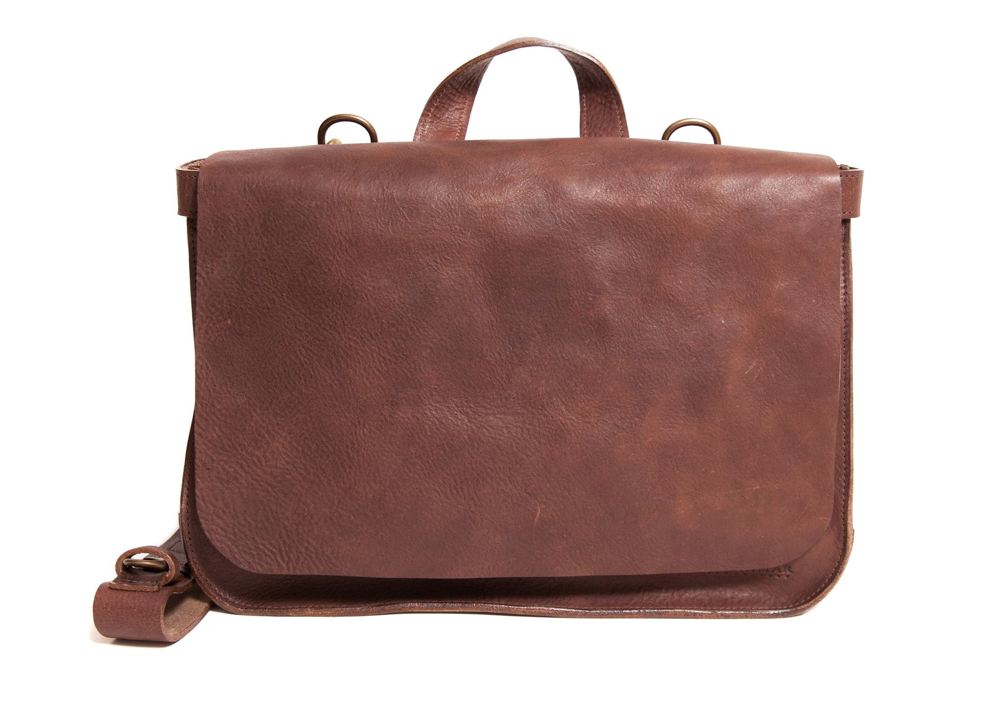 """Vegetable-tanned leather flapover messenger bag. Removable, adjustable shoulder strap allows the bag to be worn as a messenger or backpack. Fits most 15"""" laptops."""