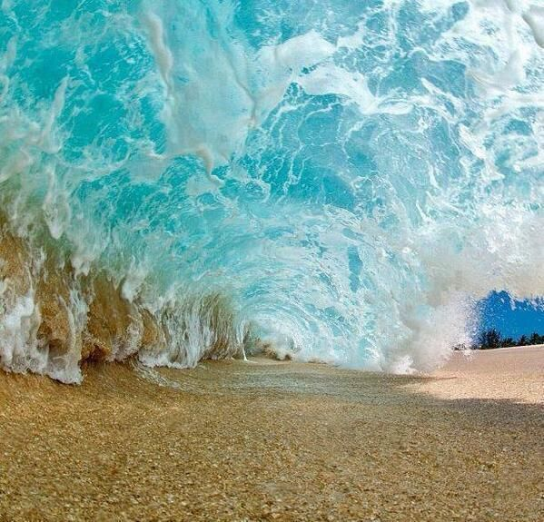 In the interior of a wave breaking. Oahu, Hawaii.