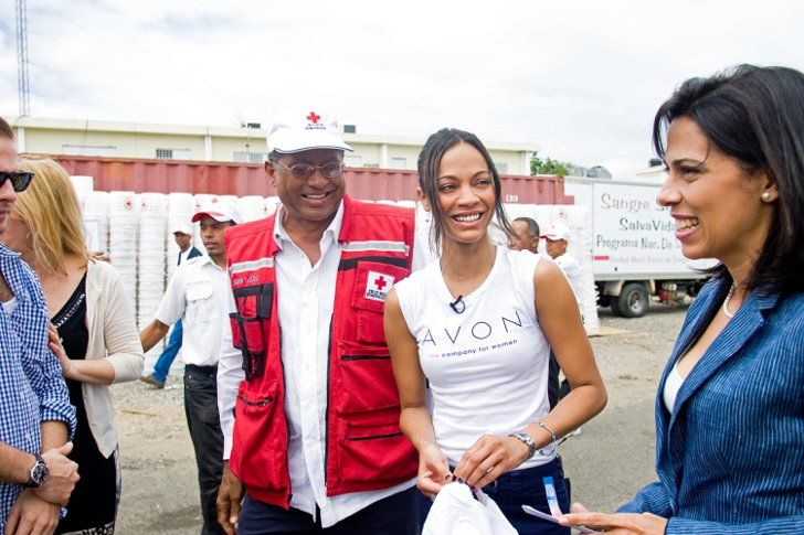 Pin for Later: 40 Pictures of Charitable Celebrities Giving Back Zoe Saldana Avon spokesperson Zoe Saldana visited the Red Cross in the Dominican Republic in February 2010.