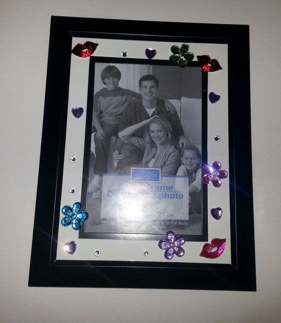 Check out this item in my Etsy shop https://www.etsy.com/listing/212695304/hand-decorated-jeweled-picture-frame
