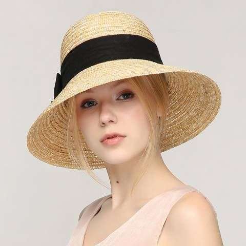 b5b908e23dd Hand woven wide brim straw hat with bow for women summer travel sun hats