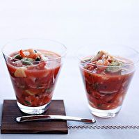 Mexican Seafood Cocktail.  Add diced cucumber, celery, and fresh jalepeno pepper. Substitute cocktail sauce for ketchup.  Use V8.  Toss the raw shrimp with cumin, corriander, chile de arbol, and a squeeze of lime juice and sauteed them in olive oil before chopping.