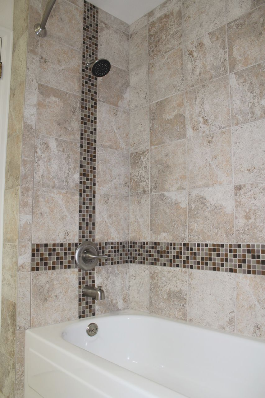 Skybridge Gray 12x24 Wall Tile Installed Vertical Stacked In Master Garden Shower Shower Wall Tile Vertical Shower Tile Shower Tile