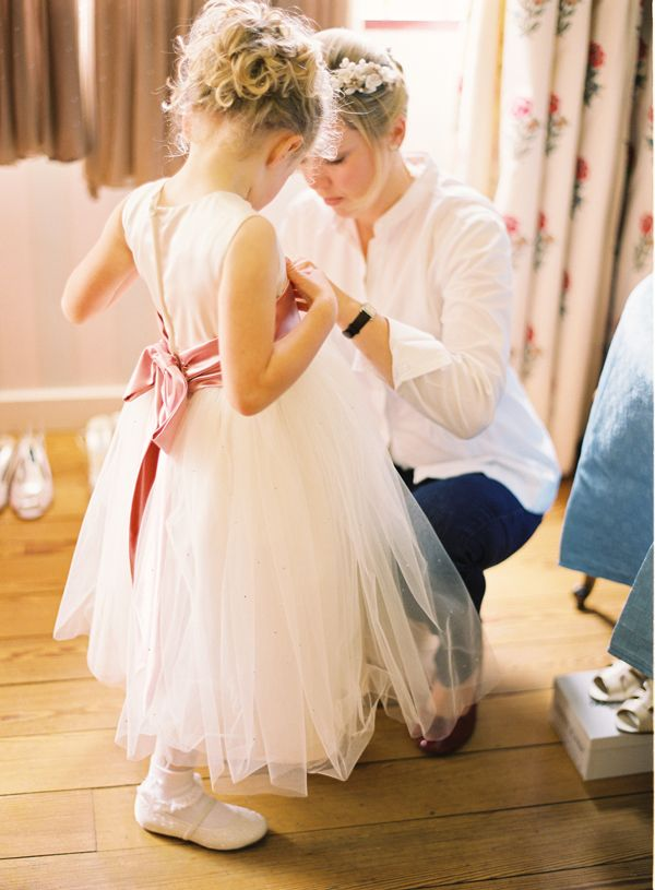White tulle flower girl dress with pink sash. Photo: Polly Alexandre