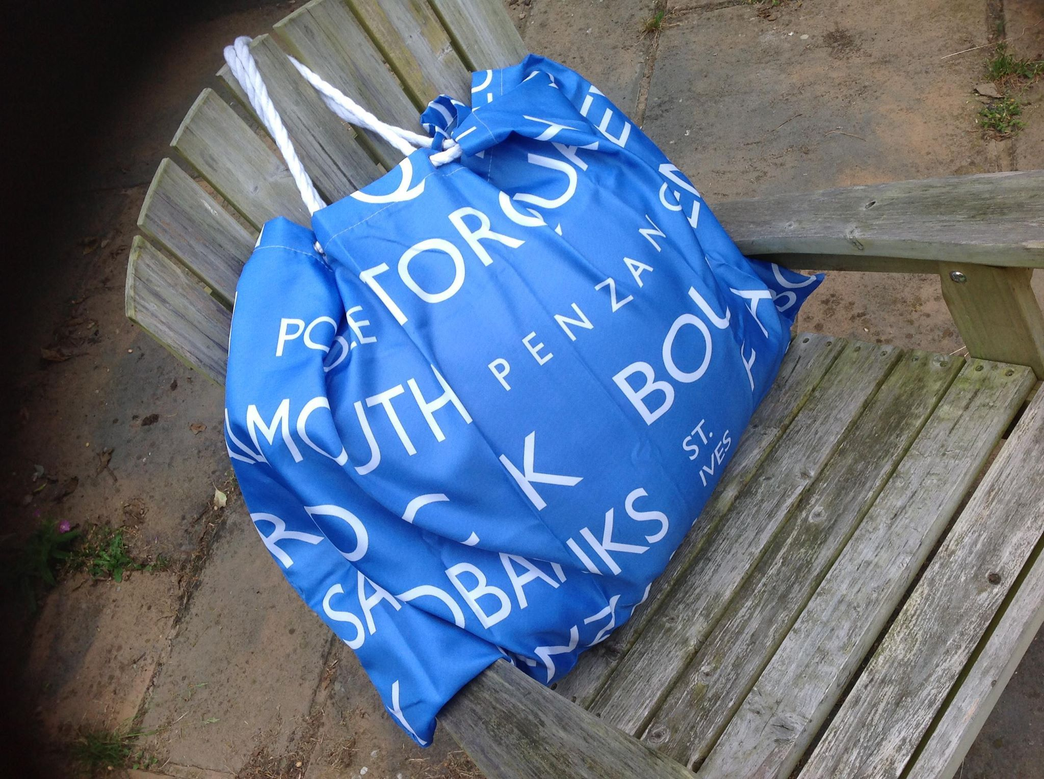 Beach bag made from shower curtain, and some white rope ...