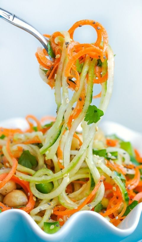Kick up your salad game with this Thai Salad with Carrot and Cucumber Noodles! Tossed in a homemade sweet and sour dressing, this tasty spiralized Thai salad is loaded with flavor! Each salad is gluten-free, vegetarian, and easily made vegan too!