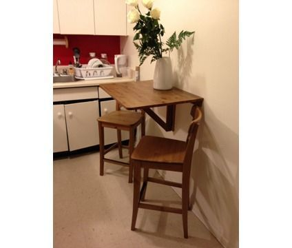 Wall-mounted drop leaf table & 2 bar stools is a Tables & Stands for ...