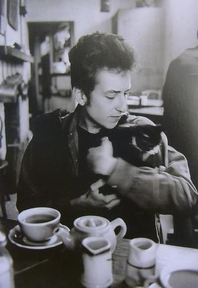Bob Dylan and a little tuxedo kitty.