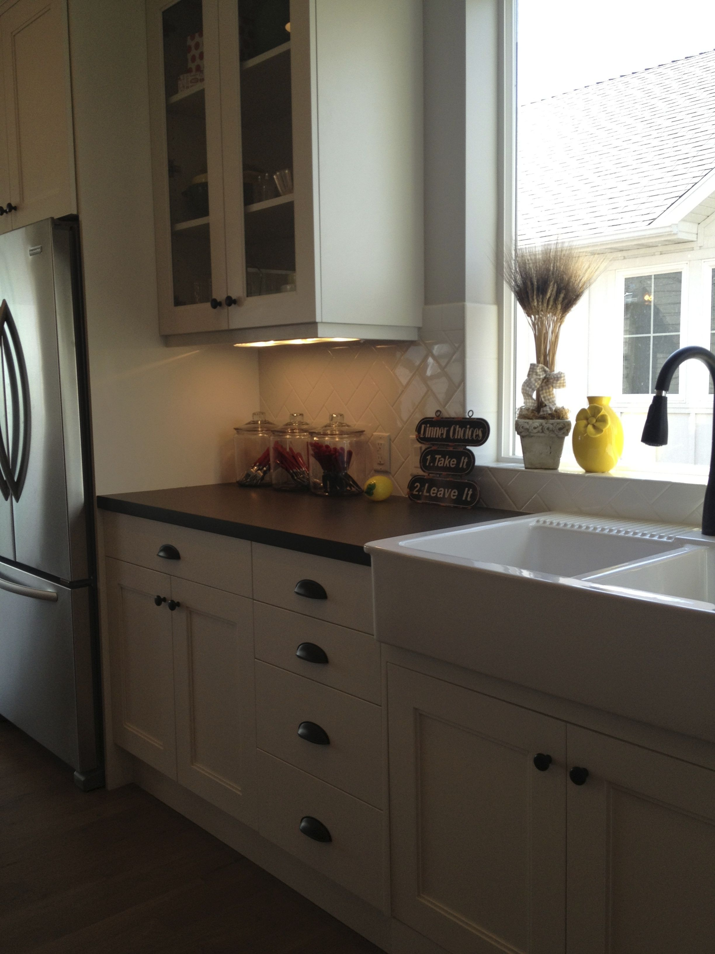 White cabinets, farmhouse sink, oil rubbed bronze hardware and ...