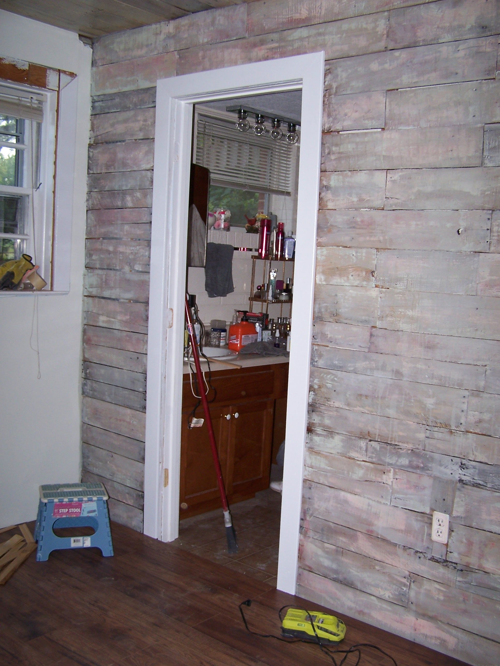 Here is the pallet wood wall i added to my basement bedroom i