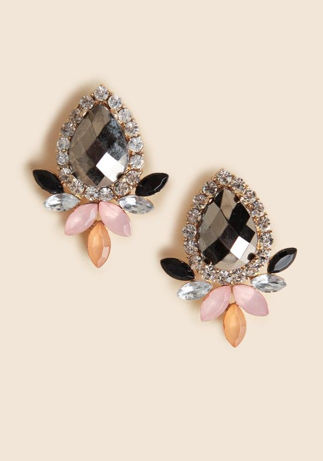 Adorned with black, clear, pastel pink and orange stones for added color, these glistening earrings pair perfectly with your favorite cocktail dresses. #shopruche #ruche