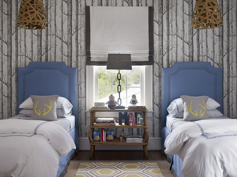 For this lucky child's bedroom, Chenault brought the outdoors in with iconic Cole & Son wallpaper, reinventing the sleeping space into a magical woodsy retreat.