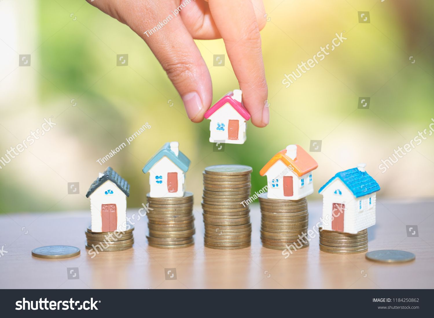 Mini house on stack of coins, Real estate investment, Save