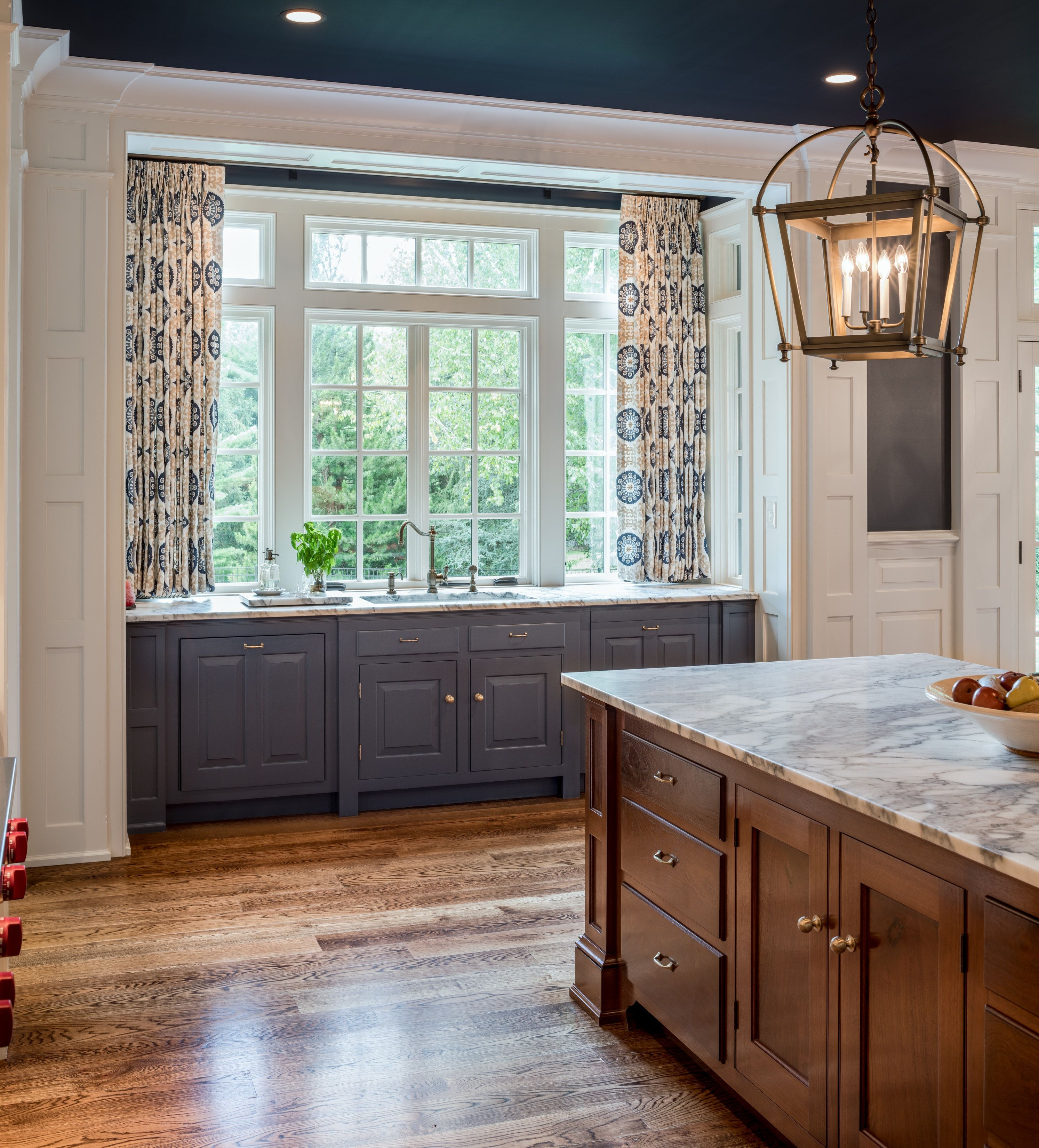 window bay at blue and white kitchen sink in Delaware