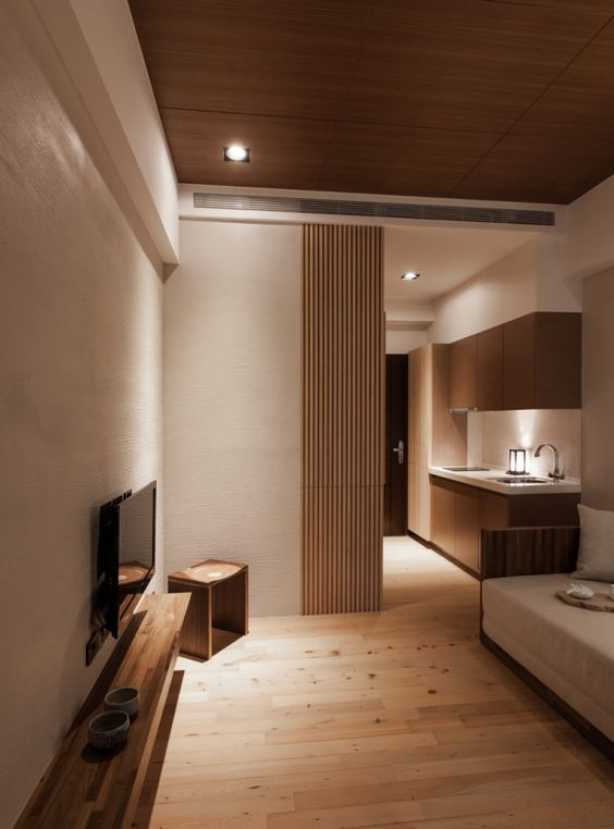 04 Modern Small Living Room With An Extensive Use Of Light Wood And Cream Walls