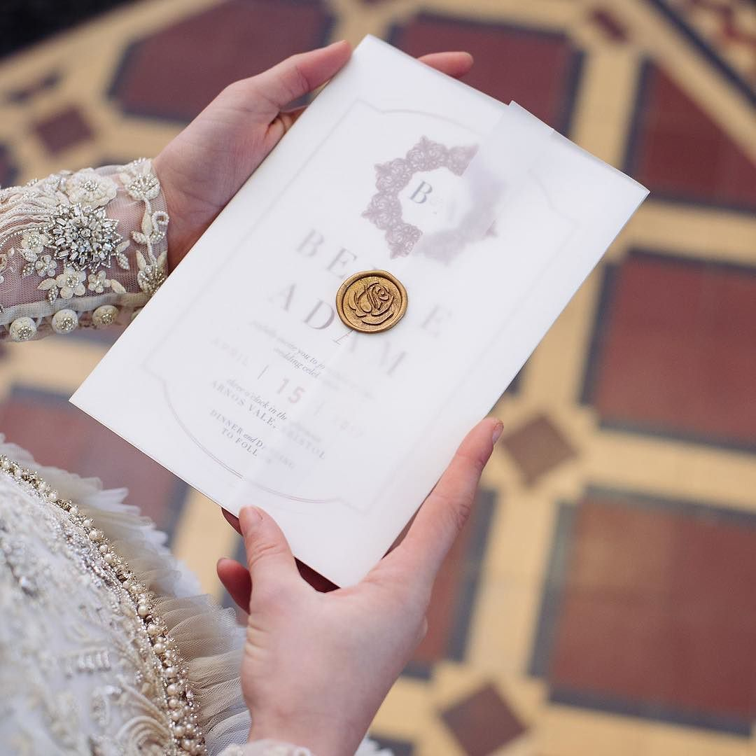 Vellum Wred Wedding Invitation Sealed With A Beautiful Gold Rose Wax Seal For Beauty And