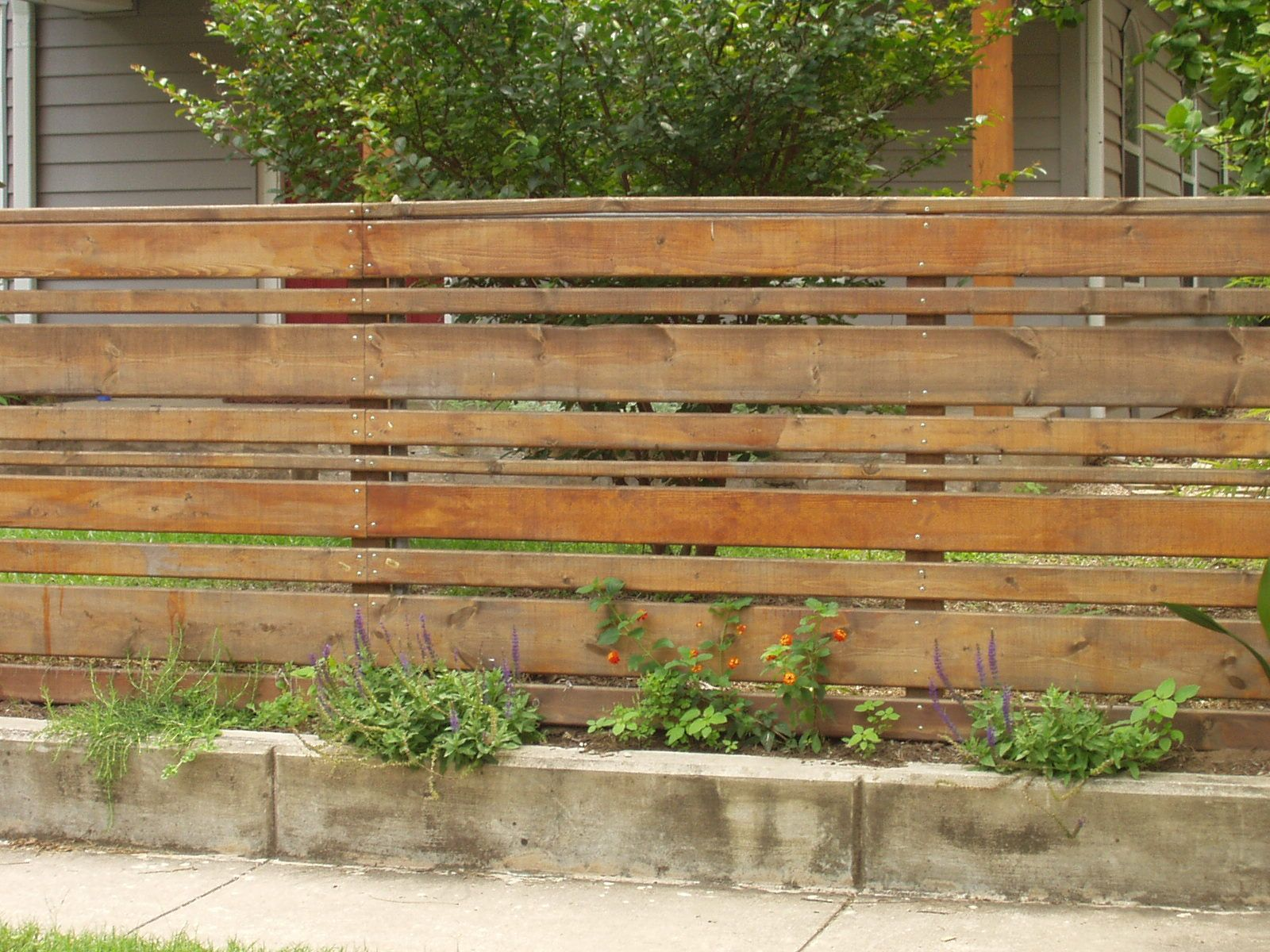 Horizontal wood slat fence with concrete base totally for Wood screen fence
